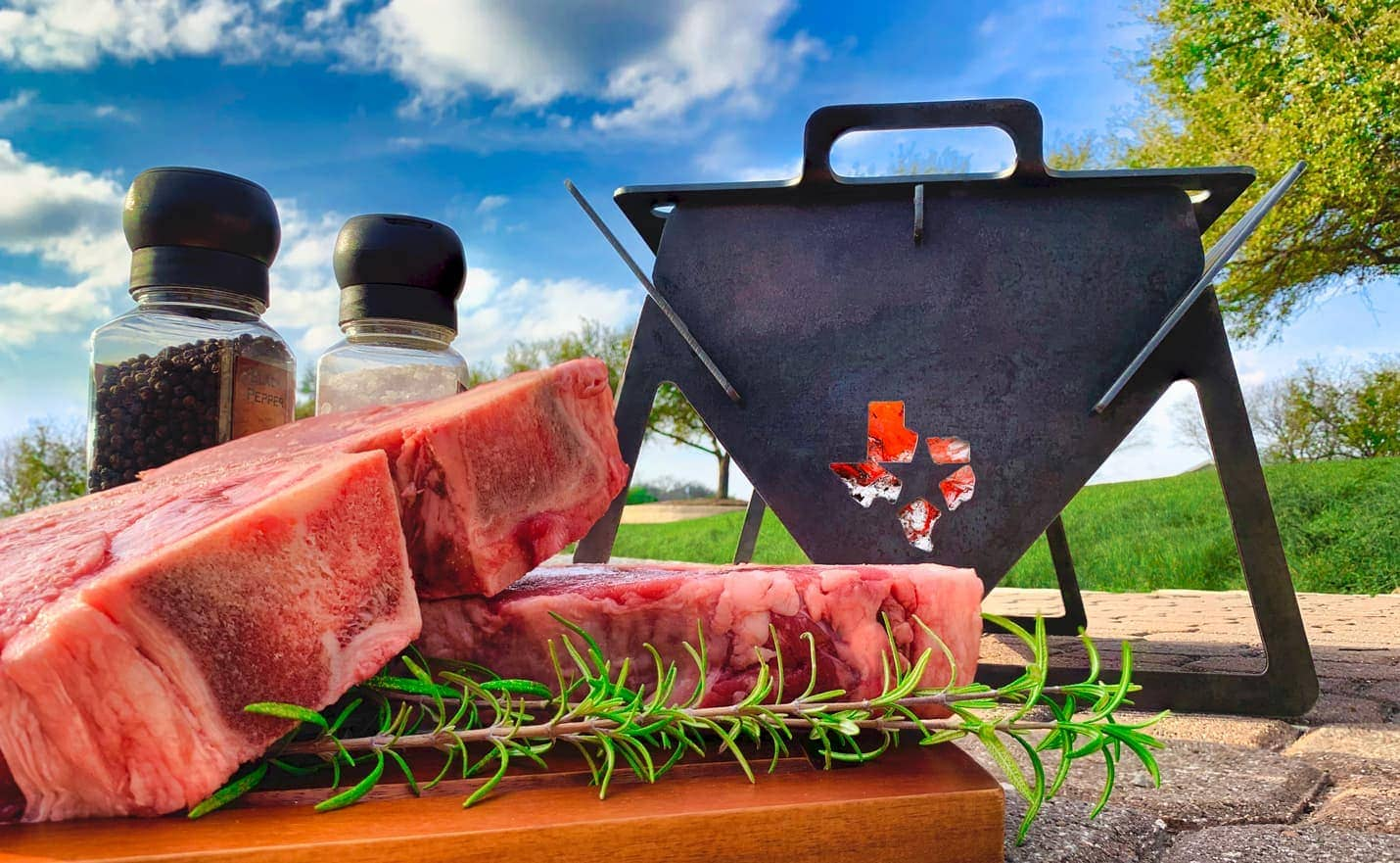 Flash Works Specialties Flat Grill with steaks